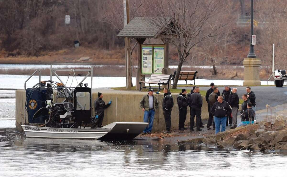 Police gather near where the Mohawk and Hudson rivers meet in Waterford after the discovery of a body Tuesday morning. Police had been searching for Patrice Zimmerman, a Colonie woman last heard from on Sunday, but they have not identitifed the body. (Skip Dickstein / Times Union)
