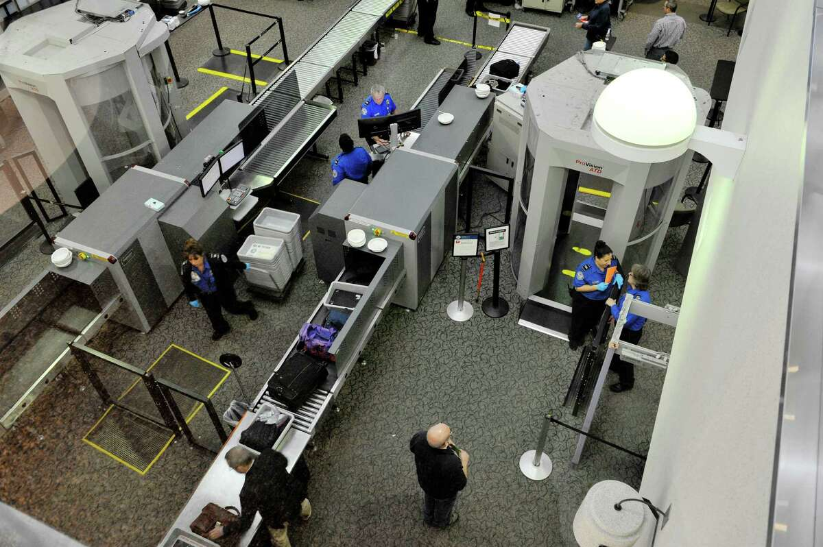 Travelers make their way through the security checkpoint at the Albany International Airport on Tuesday, Dec. 15, 2015, in Colonie, N.Y. (Paul Buckowski / Times Union)