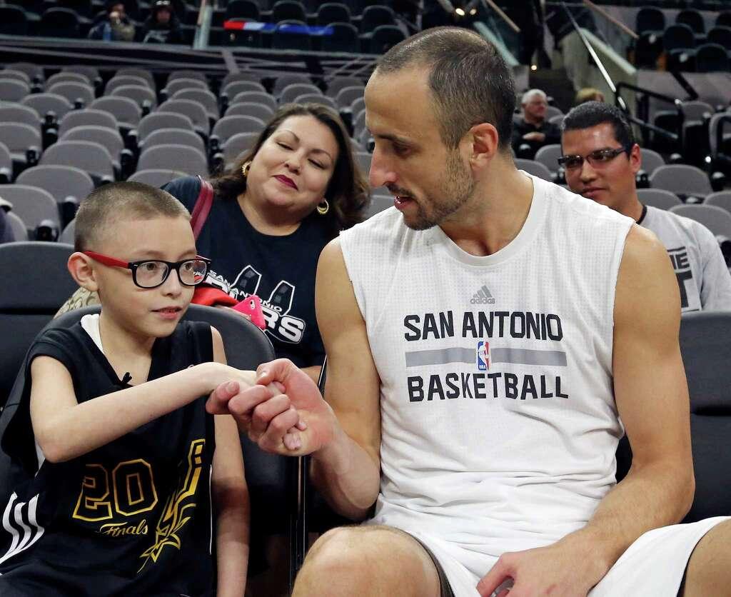 Manu Ginobili meets San Antonio boy named Ginobili at Spurs game
