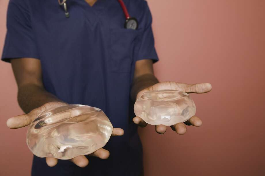 A woman is afraid to lose her boyfriend who doesn't want her to get breast implants. Photo: Patrick Lane