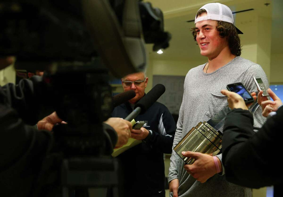 Lake Stevens High School quarterback Jacob Eason speaks with members of the media after finding out he is the Gatorade National Football Player of the Year and announcing his commitment to play for the University of Georgia next season. Photographed Dec. 15, 2015.