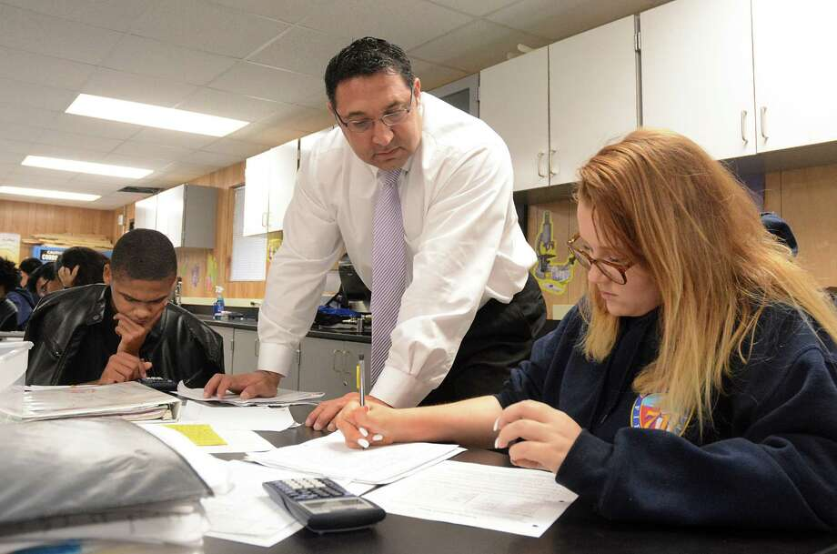 Principal Rene Garganta helps Amber Maddox with a chemistry problem, as Andrew Jackson works through an assignment on the campus of Spring ISD's Early College Academy at Southridge, 1001 Southridge Road in Spring. Photo: David Hopper, Freelance / freelance