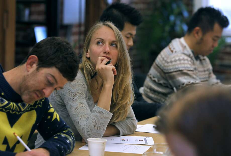 Elizabeth Kocha participates in a team building exercise with Udemy co-workers at a Breather shared meeting space on Mission Street in San Francisco, Calif. on Tuesday, Dec. 15, 2015. Photo: Paul Chinn, The Chronicle