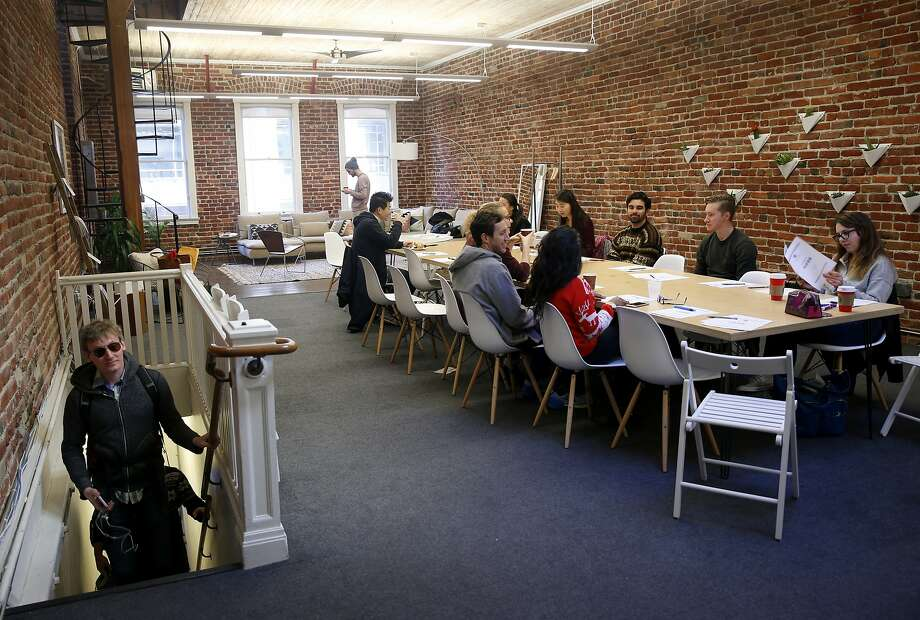 Udemy employees attend a team building presentation at a Breather shared meeting space on Mission Street in San Francisco, Calif. on Tuesday, Dec. 15, 2015. Photo: Paul Chinn, The Chronicle