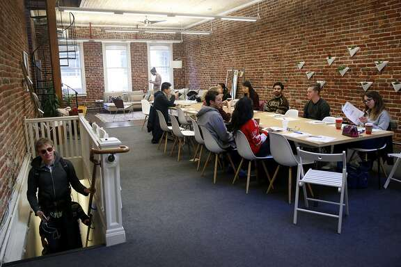 Udemy employees attend a team building presentation at a Breather shared meeting space on Mission Street in San Francisco, Calif. on Tuesday, Dec. 15, 2015.