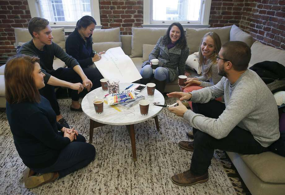 Udemy employees participate in a team building presentation at a Breather shared meeting space on Mission Street in San Francisco, Calif. on Tuesday, Dec. 15, 2015. Photo: Paul Chinn, The Chronicle
