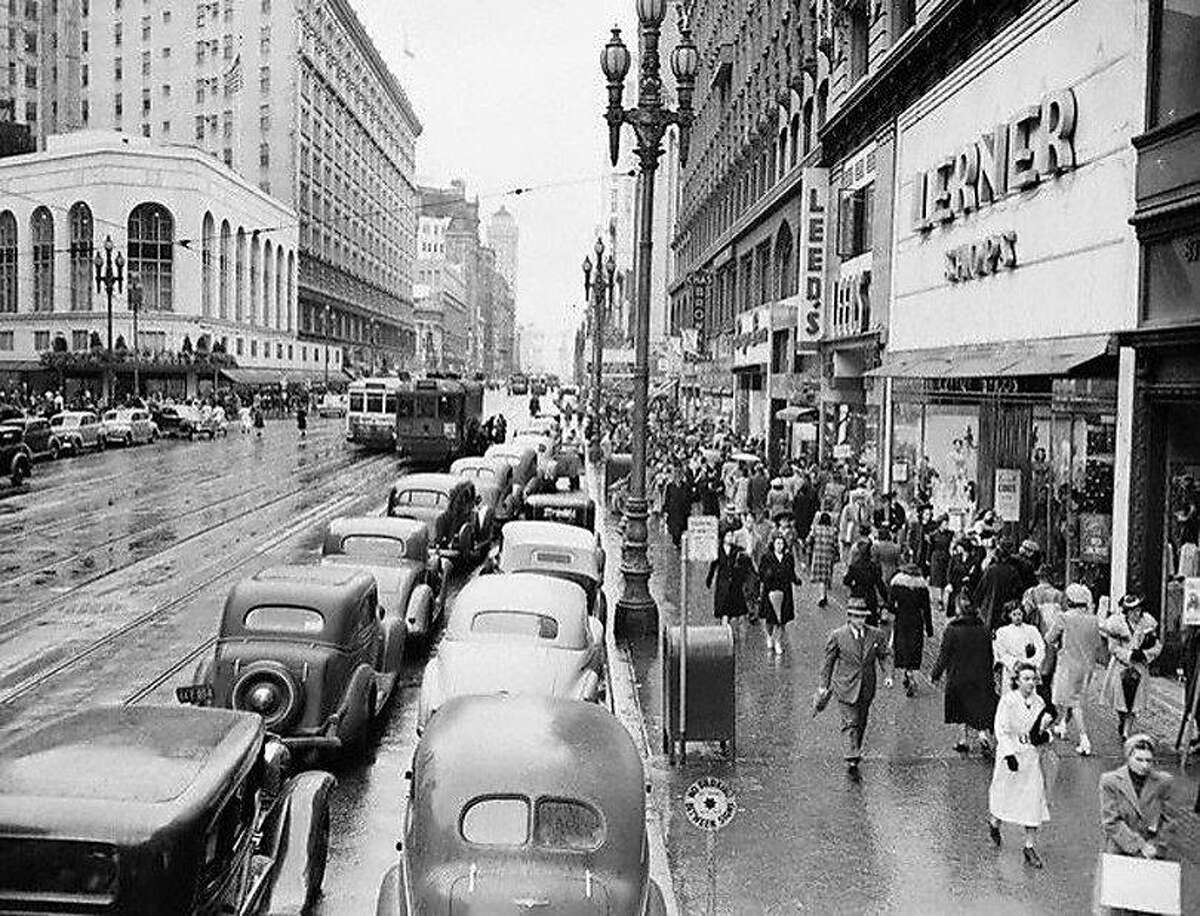 After getting their first taste of WWII blackouts, San Franciscans showed that they could take the war in stride by resuming the Christmas shopping rush where they had left off. Here's a view of Market Street during rush hour, looking toward the waterfront from Fourth Street.