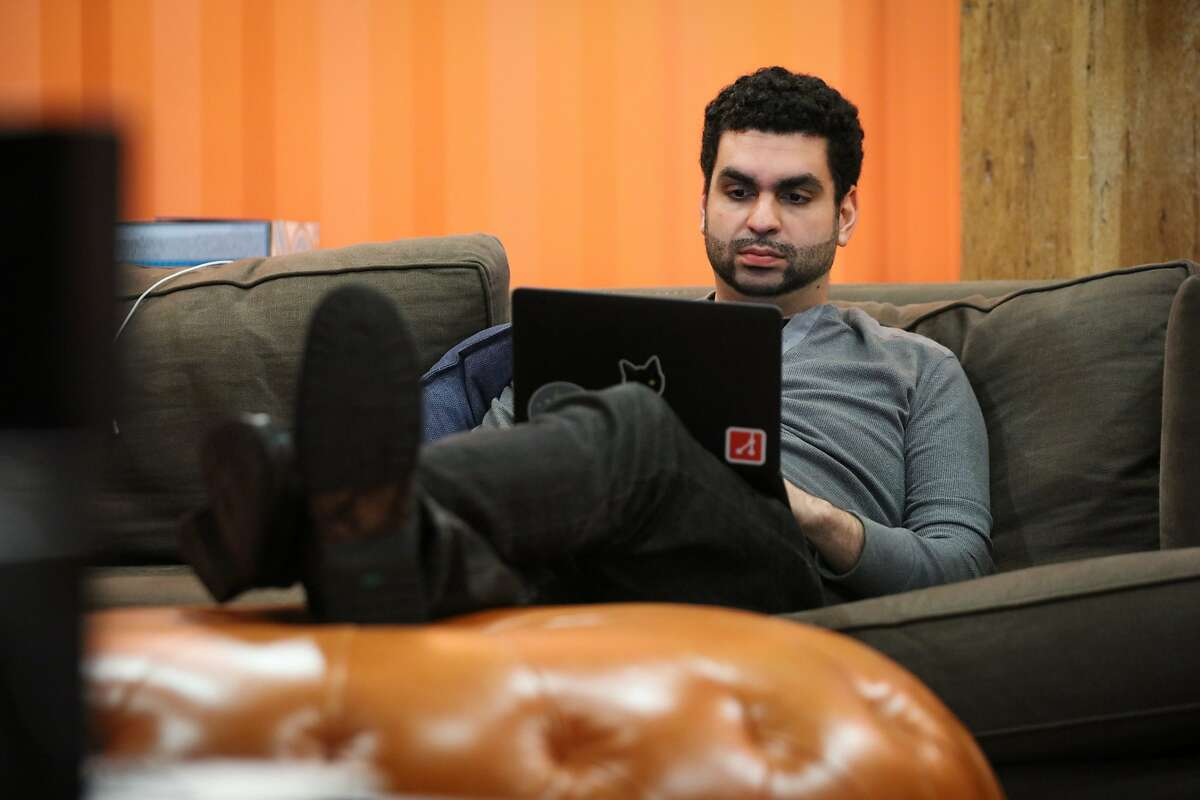 Danilo Campos, a self-taught programmer, works at the offices of tech firm GitHub, in San Francisco, California on Friday, December 11, 2015.
