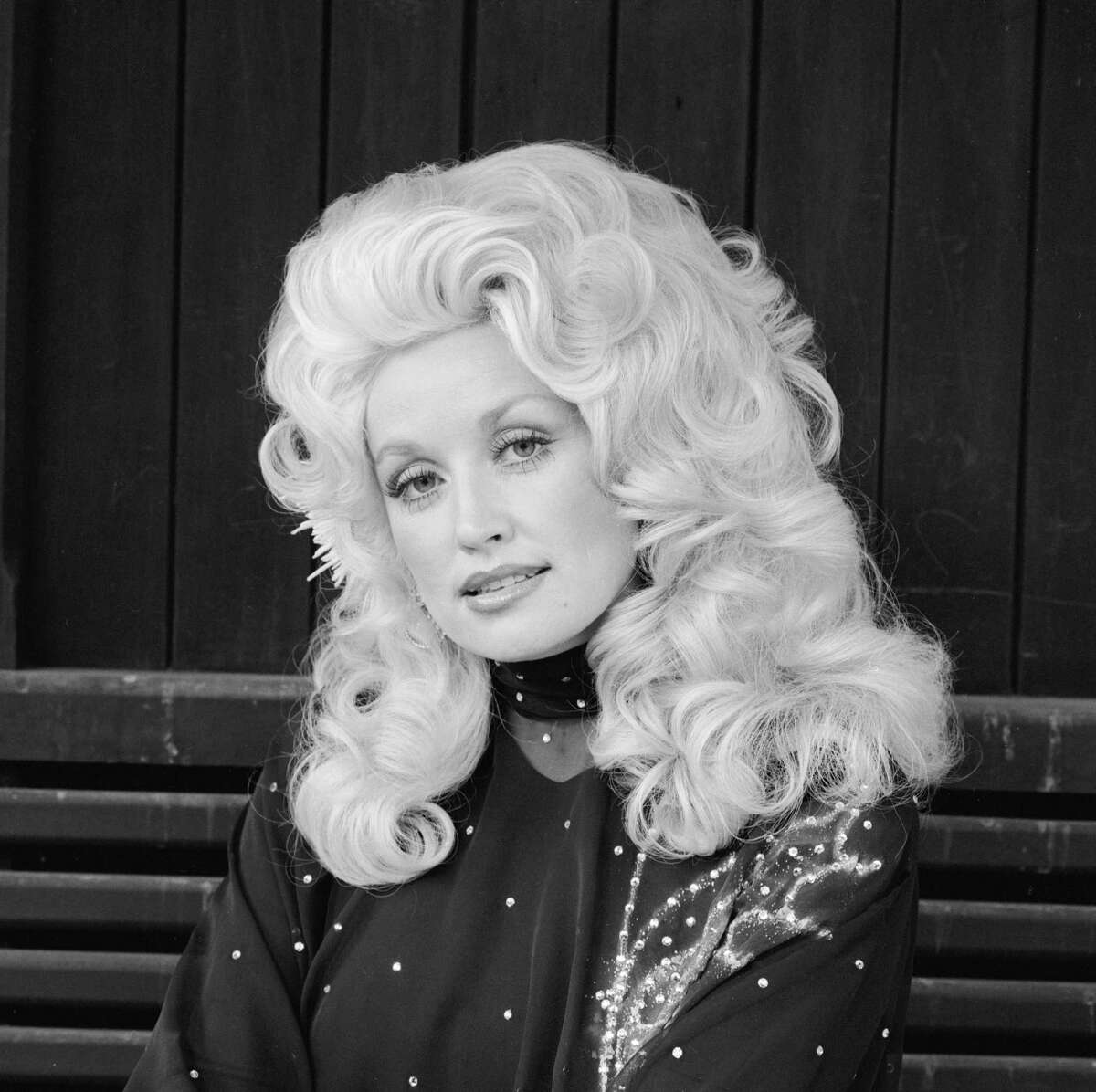 American actress and country singer Dolly Parton in London, 1977.