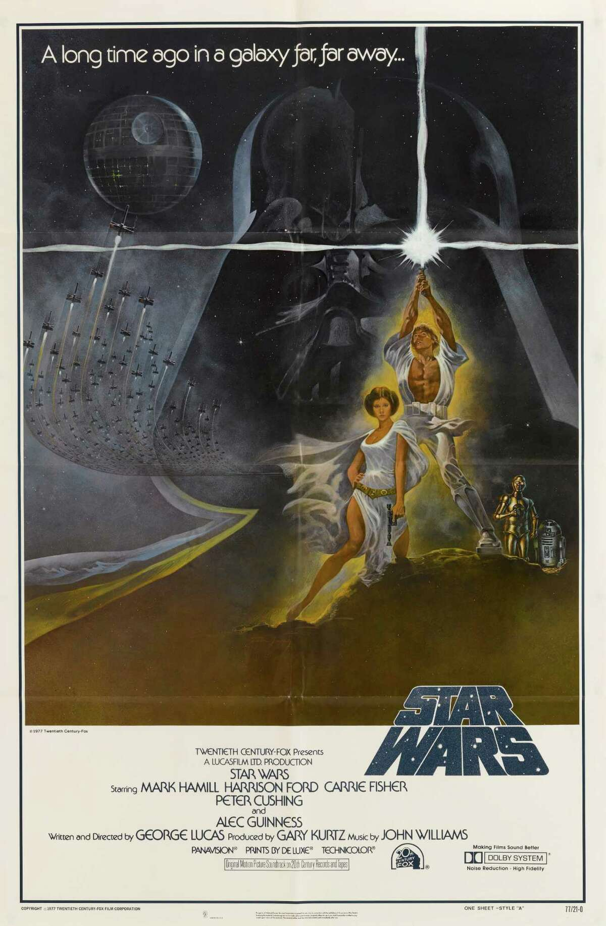 A poster for George Lucas' 1977 fantasy film 'Star Wars' starring Mark Hamill and Carrie Fisher.