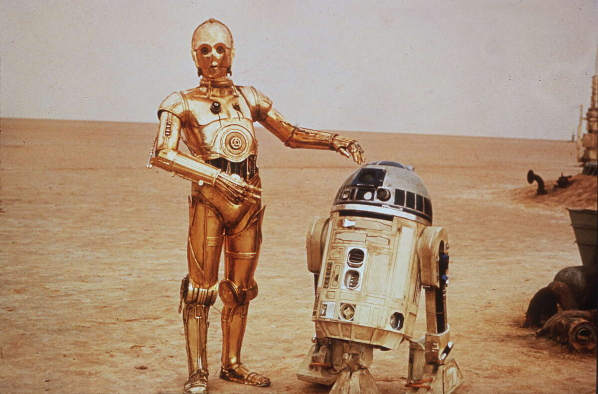 """""""Star Wars"""" scene with C3PO and R2D2 in the 1977 film."""