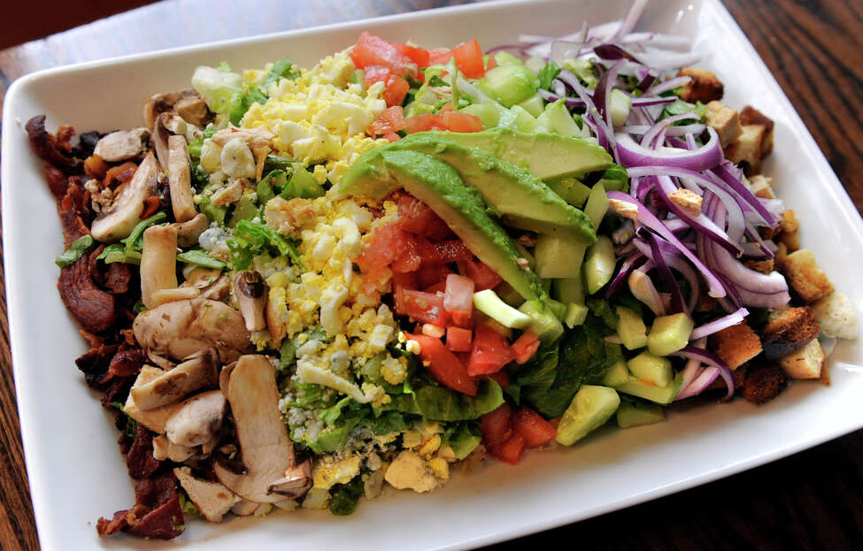 A salad with chicken is on the menu at Maggie McFly's in Southbury, Conn.