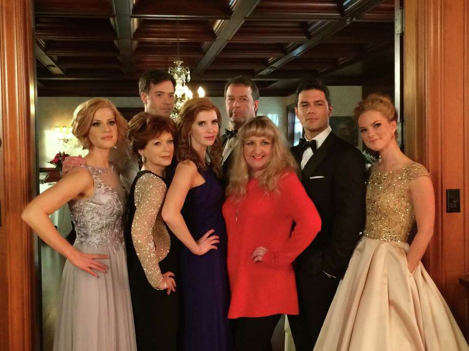 """San Antonio novelist Teri Wilson (in red) visited the Canadian set of """"Unleashing Mr. Darcy"""" and met the stars, including Ryan Paevey (in tux, on right), Cindy Busby and Frances Fisher of the Hallmark Channel movie based on her book. Photo: Courtesy Teri Wilson"""