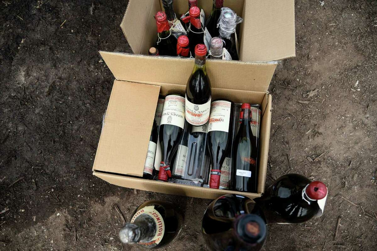 More than 500 bottles of wine found to be counterfeit or unsellable are destroyed at a landfill in Creedmoor, Texas, Dec. 10, 2015. The wine was from the private collection of Rudy Kurniawan, the man convicted of fraud in federal court in 2013 for producing and selling millions of dollars of counterfeit wine.