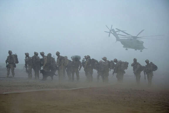 US Marines from the 2nd Battalion, 8th Marine Regiment of the 2nd Marine Expeditionary Brigade wait for helicopter transport as part of Operation Khanjar at Camp Dwyer in Helmand Province in Afghanistan on July 2, 2009.  US Marines launched a major offensive into the Taliban heartlands of southern Afghanistan before dawn as President Barack Obama's new war plan swung into action. With dozens of aircraft ferrying out troops from various bases, the assault aimed to insert forces into insurgent strongholds in Helmand province in what officers said was the biggest offensive airlift by the Marines since Vietnam. Operation Khanjar (Strike of the Sword), involving nearly 4,000 US forces as well as 650 Afghan police and soldiers, would bring security to the Helmand River valley ahead of presidential elections on August 20, commanders aid.  TOPSHOTS  AFP PHOTO/  Manpreet ROMANA
