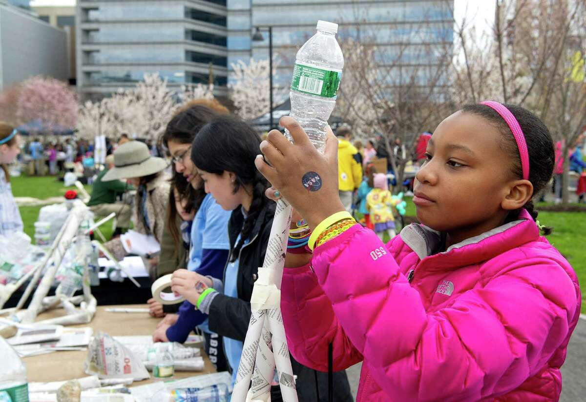 Damaris Channer, 12, creates something out of recycled materials at By Kids For Kids' table at STEMfest, an event to promote science, technology, engineering and math skills at Mill River Park in Stamford, Conn., on Saturday, April 26, 2014.