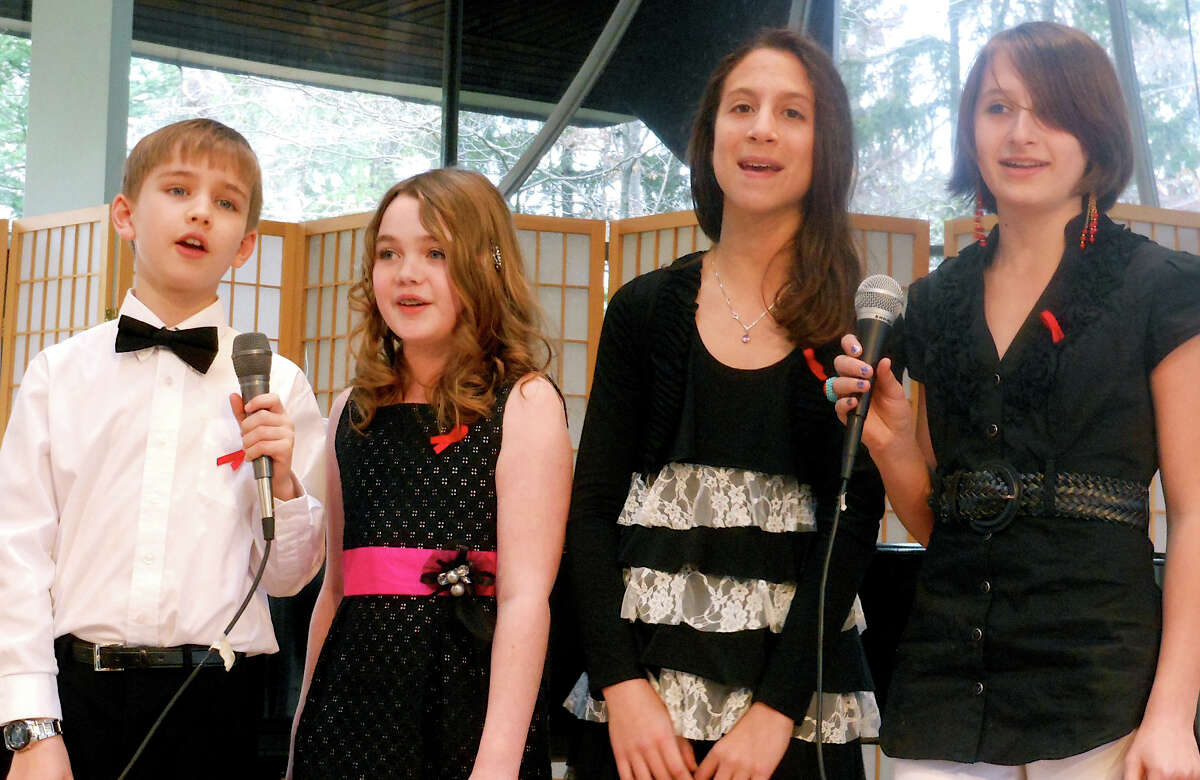 Luke Sauer, Hillary O'Neill, Carlie Darefsky and Nicole Kiker perform at Sunday's Kids for Kids concert at the Unitarian Church in Westport in March.