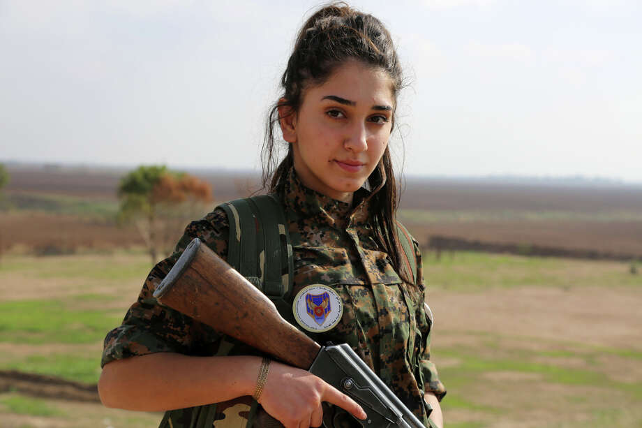 """Syriac Christian Ormia, member of the battalion called the """"Female Protection Forces of the Land Between the Two Rivers"""" fighting the Islamic State group, poses during a training on December 1, 2015 at their camp in the town of al-Qahtaniyah, near the Syrian-Turkish border (aka Kabre Hyore in Syriac, and Tirbespi in Kurdish). The 50 graduates that counts the battalion are following in the footsteps of Syria's other main female force battling the jihadists -- the women of the YPJ, the female counterpart to the Kurdish People's Protection Units or YPG.  AFP PHOTO / DELIL SOULEIMAN / AFP / DELIL SOULEIMAN Photo: DELIL SOULEIMAN, Getty Images / AFP"""