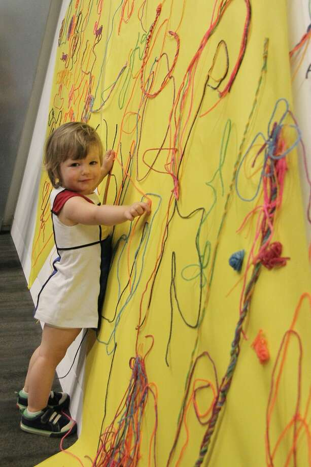 Little girl working with Wikki Stix at the Contemporary Jewish Museum. Photo: Picasa, Courtesy Of CJM