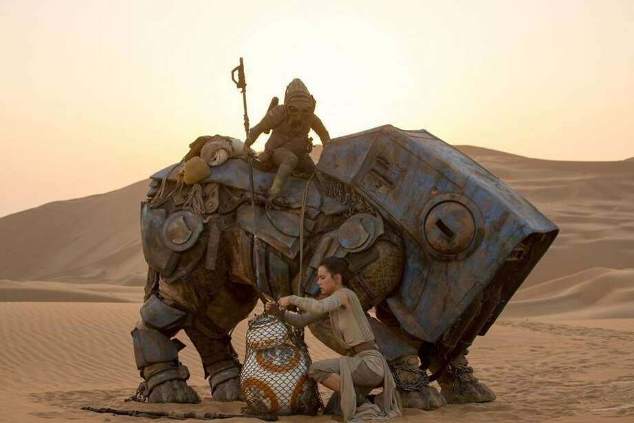 "Daisy Ridley plays resourceful Rey, in possession of a cute but essential robot, in the seventh film in the ""Star Wars"" series. Photo: Handout, McClatchy-Tribune News Service"