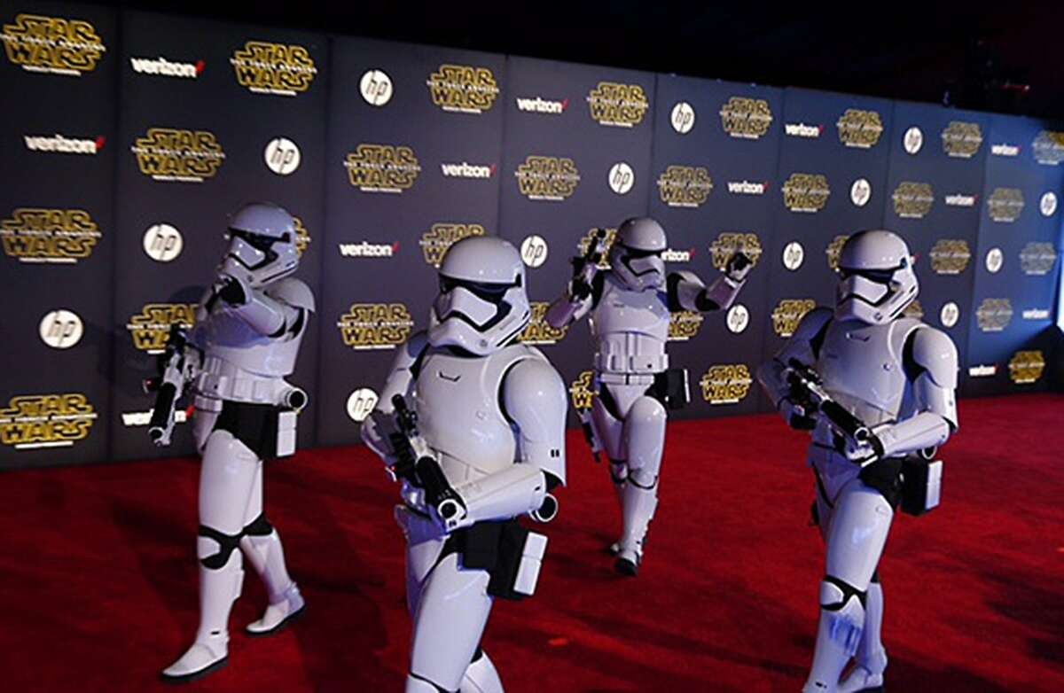 """Empire stormtroopers, a series mainstay, walk the red carpet at the Hollywood premiere of """"Star Wars: The Force Awakens."""""""