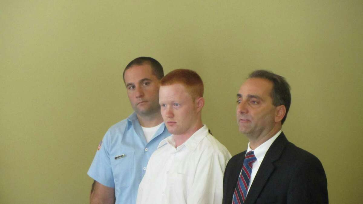 From right, Rensselaer County Public Defender John Turi, Brendan Hoffman, and an unidentified state correction officer. (Bob Gardinier / Times Union)