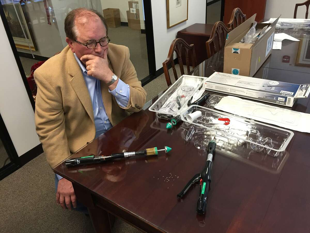 Richard Alexander displays the PPH 03 hemorrhoid stapler. his client, Florence Kuhlmann, was awarded nearly $80 million in damages after a jury ruled one of the devices was defective.