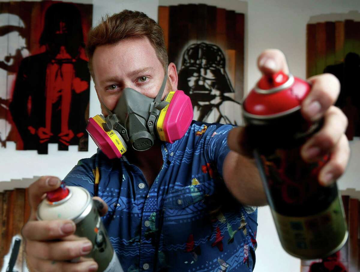 Artist Jon Garner paints a variety of themes, but one of the most in demand right now are his range of Star Wars themed paintings in his studio, Tuesday, Dec. 15, 2015, in Houston.