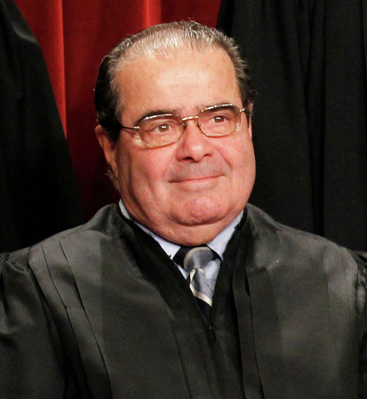 Justice Antonin Scalia poses for a group portrait of the Supreme Court in this file photo.