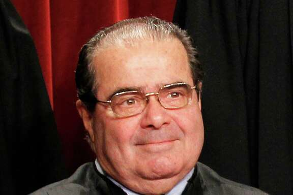 Associate Justice Antonin Scalia is seen during the group portrait, Friday, Oct. 8, 2010, at the Supreme Court in Washington. (AP Photo/Pablo Martinez Monsivais)