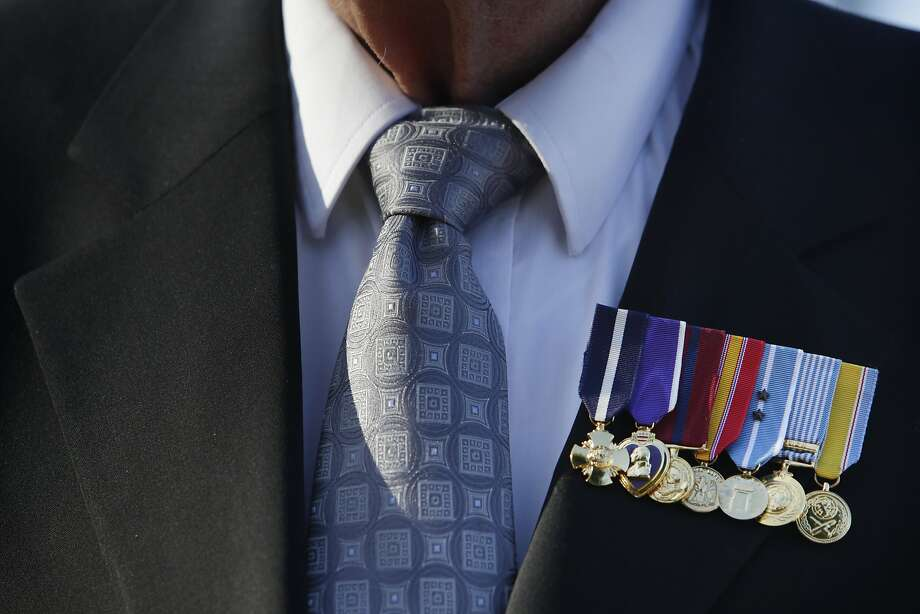 """Medals awarded to Korean War veteran William """"Denny"""" Weisgerber, retired gunnery sergeant,  are worn on his jacket during a visit to the site of The Korean War Memorial at the Presidio of San Francisco, which is under construction, on Tuesday, December 15,  2015 in San Francisco, Calif. Photo: Lea Suzuki, The Chronicle"""