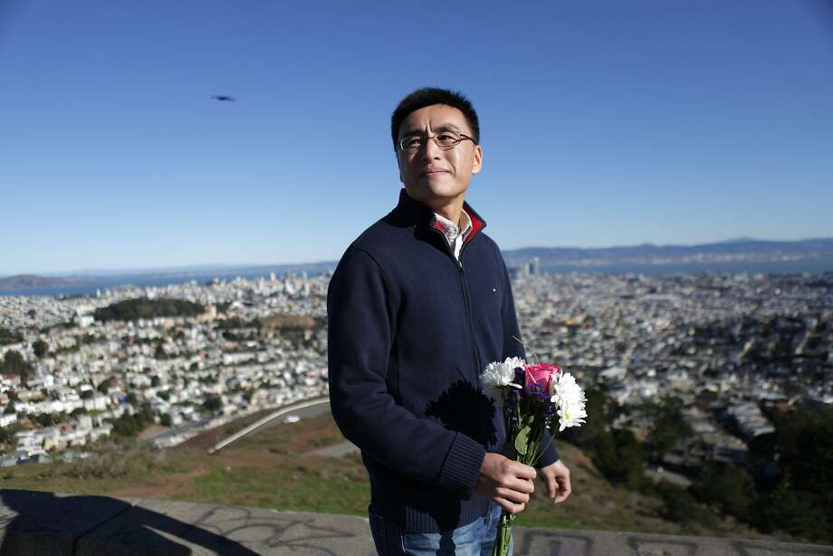 Kai Yuan, of San Francisco, carries a bouquet of flowers to place near the site of where his mother was hit by a car and died and two friends who were injured in the same incident on December 20, 2012 as he walks near the intersection of Twin Peaks Boulevard and Christmas Tree Point Lane on Tuesday, December 15,  2015 in San Francisco, Calif. Photo: Lea Suzuki, The Chronicle