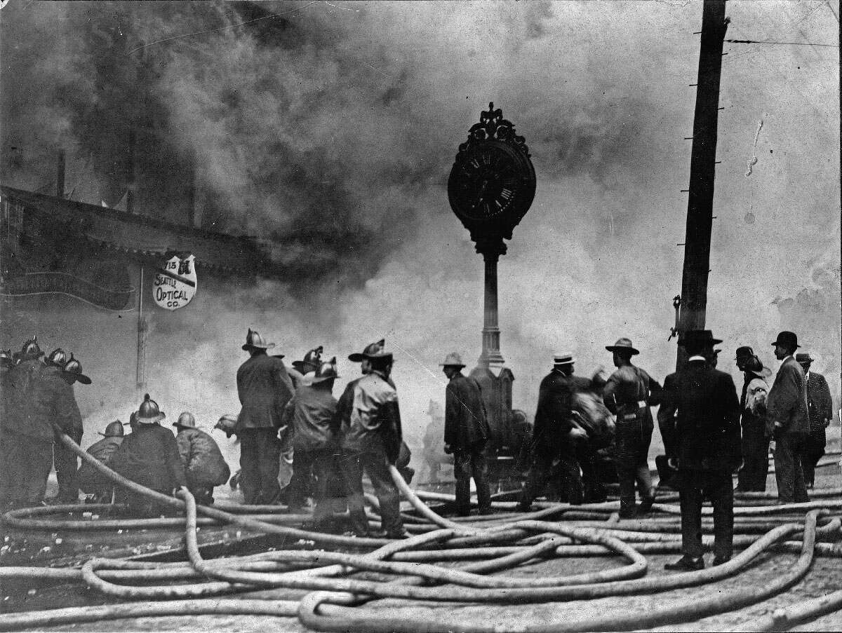 Firefighters battle a blaze at the corner of Second Avenue and Cherry Street. Pictured 1908.