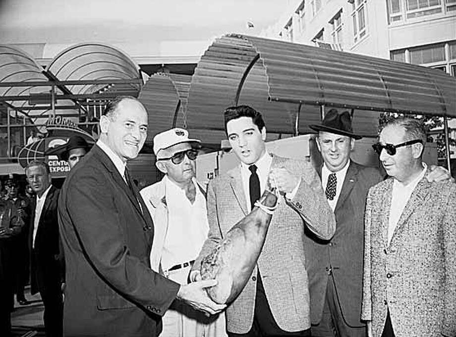 A Federal Way man who led what his attorney described as a ring of 'pathetic crowd of fellow addicts' in id theft spree against dozens of people says it all came apart for him when his wife ran off with an Elvis impersonator. The actualElvis Presley is pictured above presenting a ham to Washington Governor Al Rosellini at Seattle's Westlake Avenue Monorail station in 1962. Photo: Seattle Post-Intelligencer Archive, As Preserved By The Museum Of History & Industry