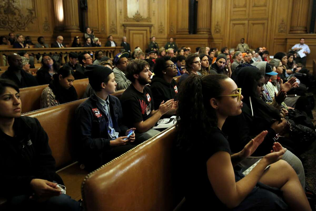 The audience applauds a supervisor's position on the new jail proposal during a Board of Supervisors meeting at City Hall in San Francisco, California, on Tuesday, Dec. 15, 2015.