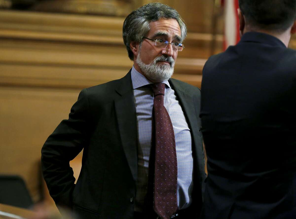 Supervisor Aaron Peskin speaks to another supervisor during a Board of Supervisors meeting at City Hall in San Francisco, California, on Tuesday, Dec. 15, 2015.