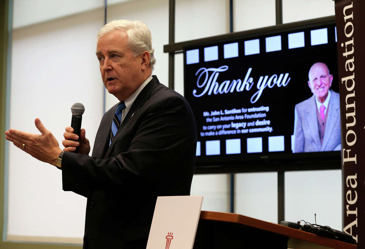 Dennis E. Noll, President and CEO of the San Antonio Area Foundation, speaks Tuesday December 15, 2015 during a press conference detailing a gift donated to the San Antonio Area Foundation by the estate of local cinema businessman and real estate entrepeneur John L. Santikos (pictured, right). The gift has an estimated value in excess of $605 million. Santikos gifted the bulk of his estate including his theater and real estate businesses. The donation will support a wide range of charitable programs in the area and will more than triple the community foundation's asset size.