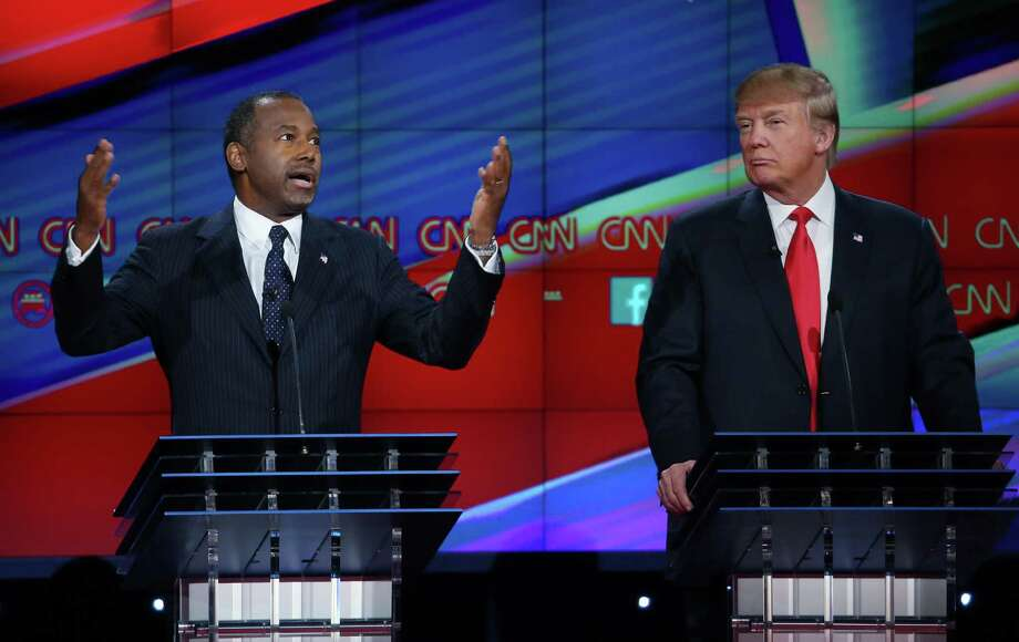 Republican presidential candidate Ben Carson (L) speaks as Donald Trump listens during the CNN Republican presidential debate on December 15, 2015 in Las Vegas, Nevada. Photo: Justin Sullivan, Getty Images / 2015 Getty Images