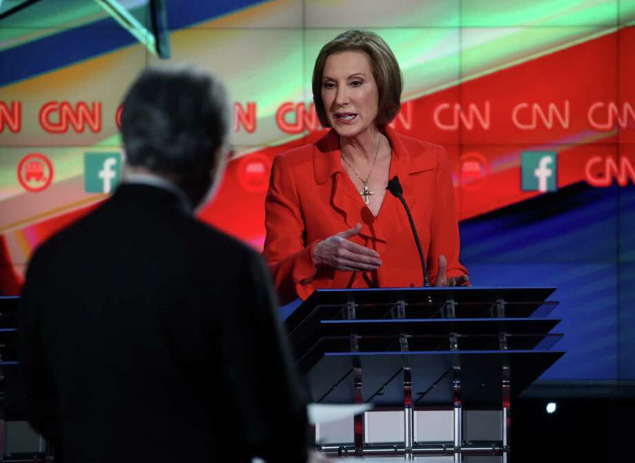 LAS VEGAS, NV - DECEMBER 15:  Republican presidential candidate Carly Fiorina (R) speaks during a CNN Republican presidential debate in Las Vegas last December. Photo: Justin Sullivan, Getty Images / 2015 Getty Images
