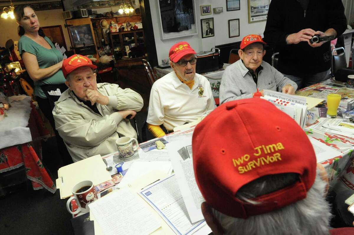 WWII Marine veteran who fought at Iwo Jima, left to right, Sal Famularo, Dick Varone, Tom Lemme and Thomas Smith, back to camera, meet at the Home Front Cafe on Thursday Dec. 10, 2015 in Altamont, N.Y. (Michael P. Farrell/Times Union)