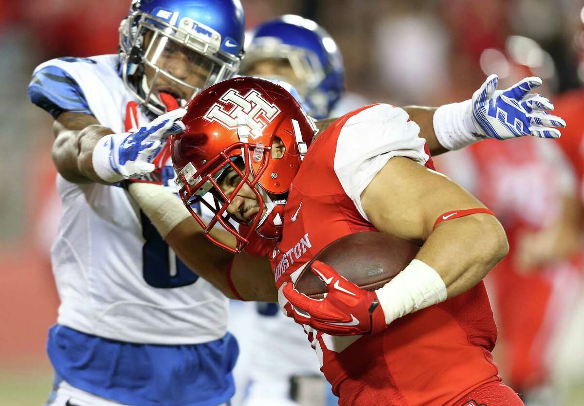 Houston Cougars running back Kenneth Farrow (35) plows his way into the end zone for a touchdown in the second half of game action between UH Cougars and Memphis Tigers on Saturday, Nov. 14, 2015, in Houston. Houston won the game 35-34. ( Elizabeth Conley / Houston Chronicle )
