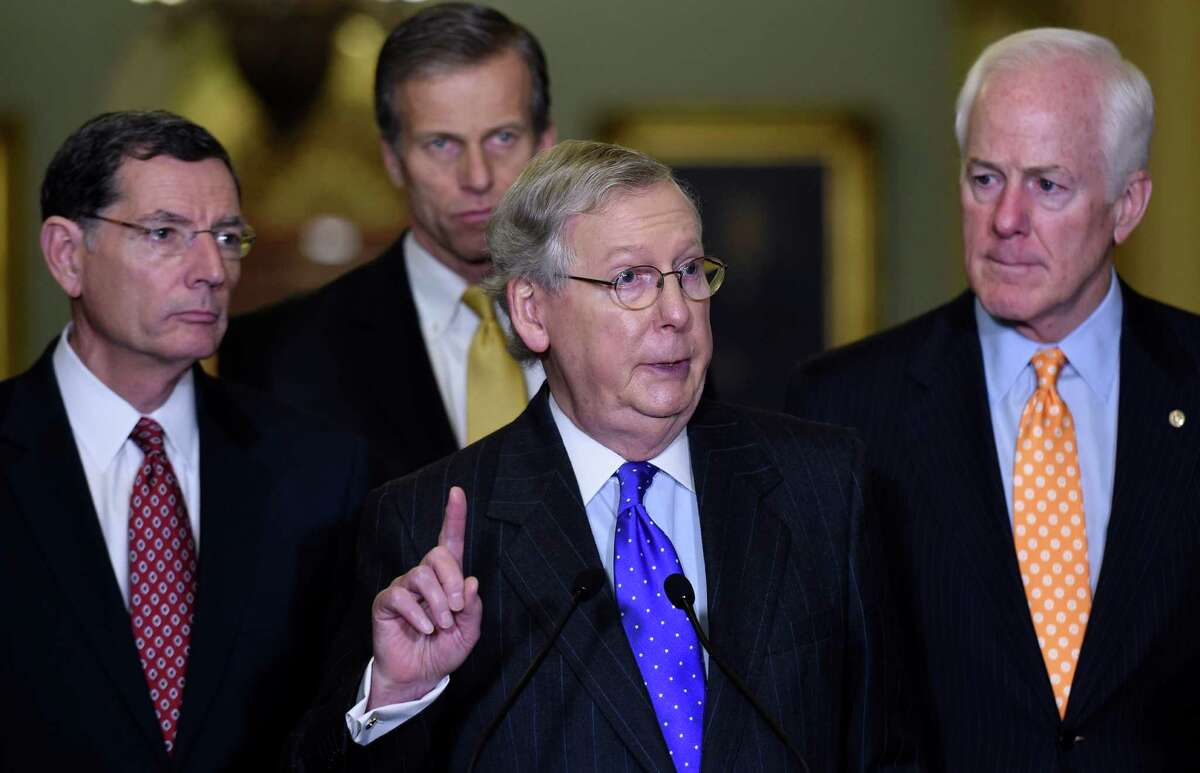 Senate Majority Leader Mitch McConnell of Ky., center, accompanied by, from left, Sen. John Barrasso, R-Wyo., Sen. John Thune, R-S.D., and Senate Majority Whip John Cornyn of Texas. (AP Photo/Susan Walsh)