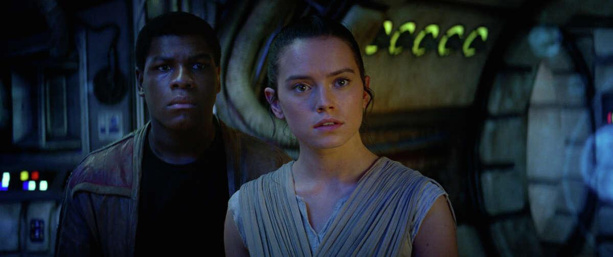 Finn (John Boyega) and Rey (Daisy Ridley) in a still frame from