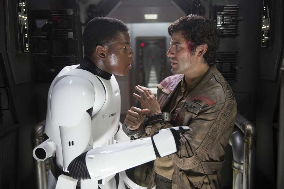 "Finn (John Boyega) and Poe Dameron (Oscar Isaac) in a still frame from ""Star Wars: The Force Awakens."" Photo: 2015 Lucasfilm Ltd. & TM. All Right Reserved."