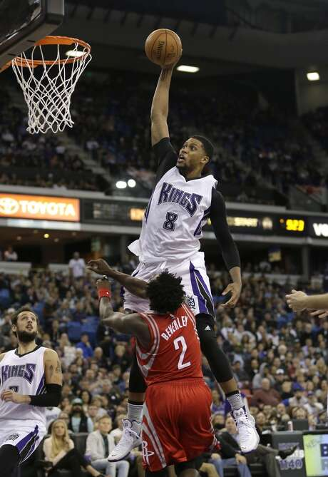 Sacramento Kings forward Rudy Gay goes up for a dunk over Houston Rockets guard Patrick Beverley during the second half of an NBA basketball game in Sacramento, Calif., Tuesday, Dec. 15, 2015. The Kings won 107-97. (AP Photo/Rich Pedroncelli) Photo: Rich Pedroncelli, Associated Press