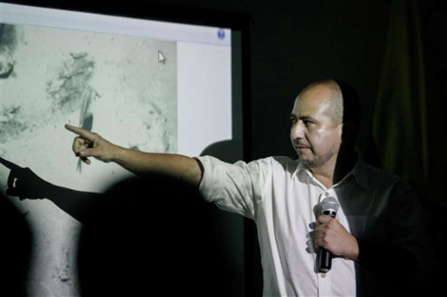 Ernesto Montenegro, Director of the Colombian Institute of Anthropology and History of Colombia, talks to the media while he shows a picture of remains of the Galleon San Jose during a press conference in Cartagena, Colombia, Saturday, Dec.5, 2015. Photo: Pedro Mendoza, AP
