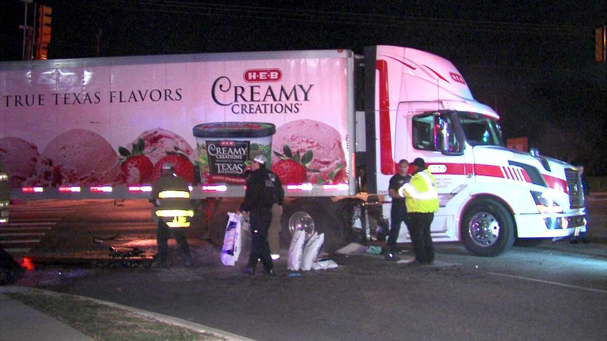 Police say a woman was injured Wednesday morning after crashing into an H-E-B 18-wheeler on the West Side.