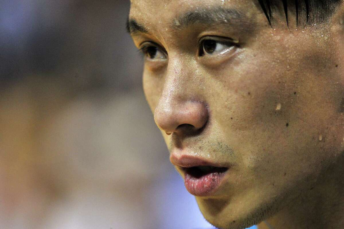 Charlotte Hornets guard Jeremy Lin talks with a reporter during half time of an NBA basketball game Friday, Dec. 11, 2015, in Memphis, Tenn. (AP Photo/Brandon Dill)