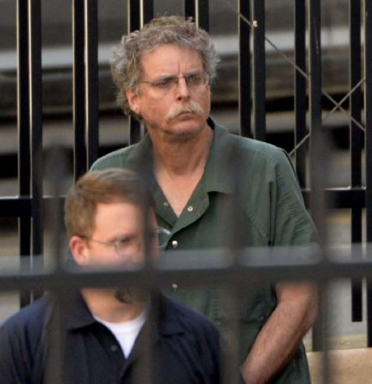 Eric J. Feight of Stockport, N.Y., leaves the Federal Courthouse in shackles after his bail was revoked Thursday afternoon, June 20, 2013, in Albany, N.Y. (Skip Dickstein/Times Union)