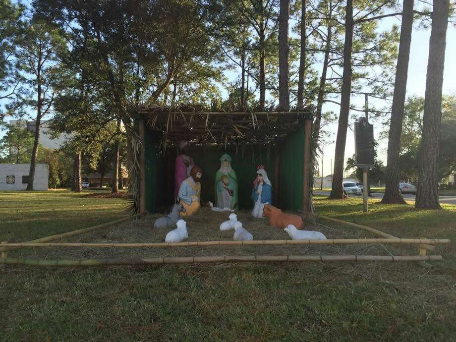 """A nativity scene at Orange's city hall was moved to Stark Park following a request by the Orange County Atheists to display a """"happy holidays"""" banner alongside the decorations. Photo: Michelle Heath"""